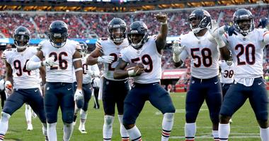 Bears linebacker Danny Trevathan (59) celebrates with teammates after recording an interception.