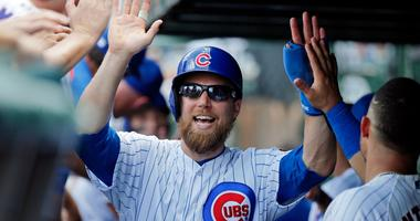 Cubs infielder/outfielder Ben Zobrist is congratulated by teammates.