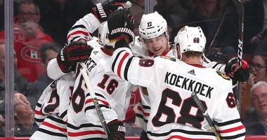 Blackhawks defenseman Connor Murphy (5) celebrates his goal against the Canadiens with teammates.