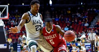 Bradley guard Darrell Brown (5) drives to the basket against Michigan State forward Xavier Tillman (23).