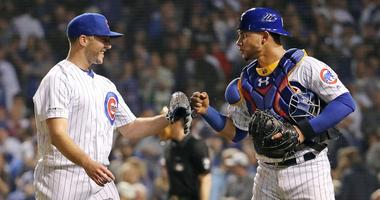 Cubs reliever Brandon Kintzler, left, catcher Willson Contreras celebrate.