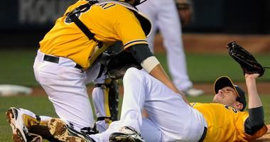 Then-Athletic pitcher Brandon McCarthy reacts after being hit by a line drive in 2011.
