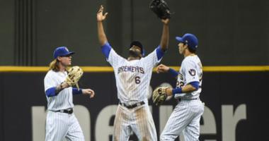 Brewers left fielder Ben Gamel (16), center fielder Lorenzo Cain (6) and right fielder Christian Yelich (22) celebrate after beating the Cubs.