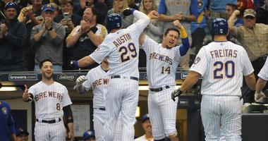 Brewers first baseman Tyler Austin (29) celebrates with third baseman Hernan Perez (14) after hitting a three-run homer against the Cubs.