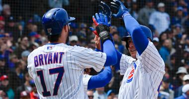 Anthony Rizzo, right, is congratulated by Cubs teammate Kris Bryant after homering.