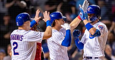 Cubs third baseman Kris Bryant (right) celebrates with teammates after hitting a grand slam against the Cardinals.