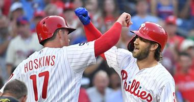 Phillies right fielder Bryce Harper (3) celebrates a homer of his with first baseman Rhys Hoskins (17).