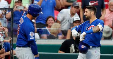 Cubs outfielder Nicholas Castellanos (right) celebrates with first baseman Anthony Rizzo (44) after hitting a homer against the Reds.