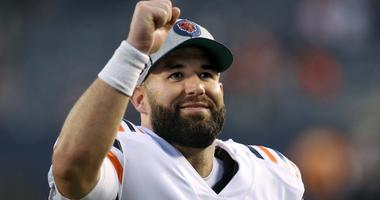 Bears quarterback Chase Daniel celebrates after a win against the Vikings.