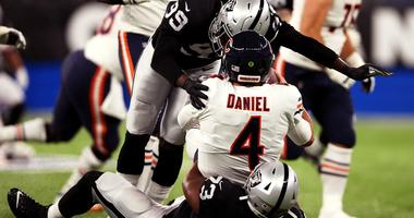 Bears quarterback Chase Daniel (4) is sacked by Raiders defensive tackle Maurice Hurst (73) and defensive end Arden Key (99).