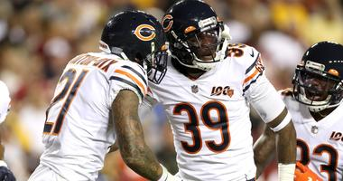 Bears safety Ha Ha Clinton-Dix (21) is congratulated by fellow safety Eddie Jackson (39) after making an interception against the Redskins.