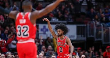 Bulls guard Coby White (0) reacts after scoring against the Knicks.