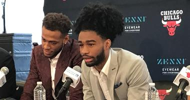 Rookie guard Coby White, right, talks at his Bulls introductory press conference.