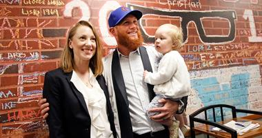New Cubs closer Craig Kimbrel, center, poses for photos at his introduction with his wife Ashely and their daughter Lydia Joy.