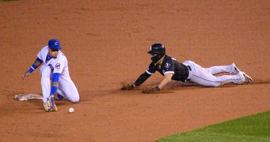 White Sox infielder Yolmer Sanchez (5) steals second base as Cubs shortstop Javier Baez (9) attempts a tag.