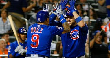 Victor Caratini (7) is congratulated by Cubs teammate Javier Baez (9) after hitting a three-run homer against the Mets.