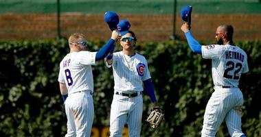 Cubs outfielders Ian Happ (8), Albert Almora Jr. (center) and Jason Heyward (22) celebrate a win against the Brewers.
