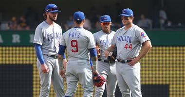 From left, Cubs infielders Kris Bryant, Javier Baez, Addison Russell and Anthony Rizzo huddle for a meeting.