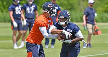 Bears running back David Montgomery, right