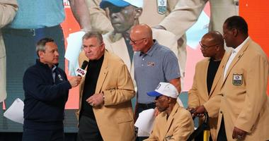 Bears legends, including Mike Ditka (second from left) and Gale Sayers (in wheelchair), took the stage at the franchise's centennial celebration.