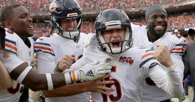 Kicker Eddy Pineiro and some Bears teammates celebrate his game-winning field goal against the Broncos.