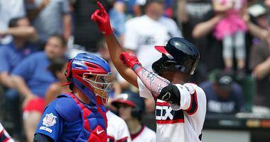 White Sox outfielder Eloy Jimenez celebrates after homering against the Cubs.