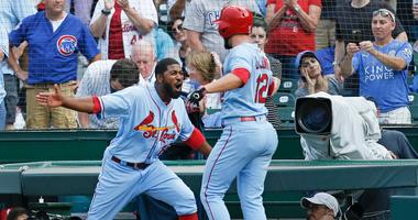 Cardinals shortstop Paul DeJong is congratulated by outfielder Dexter Fowler after hitting a go-ahead homer against the Cubs.