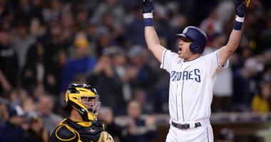 Padres second baseman Ian Kinsler (3) celebrates after hitting home run as Pirates catcher Elias Diaz (left) looks on.
