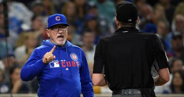 Cubs manager Joe Maddon, left, argues with umpire D.J. Rayburn.