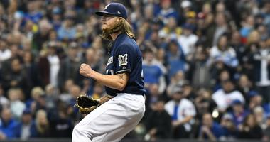 Brewers reliever Josh Hader celebrates after recording an important out against the Cubs.