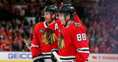 Blackhawks winger Patrick Kane (88) celebrates with defenseman Duncan Keith (2) after scoring a goal.