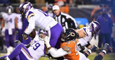 Vikings quarterback Kirk Cousins (8) is sacked by Bears linebacker Khalil Mack (52).