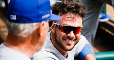 Cubs third baseman Kris Bryant, right, and manager Joe Maddon