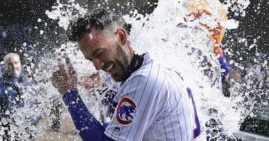 Cubs third baseman Kris Bryant is doused by teammates in celebration of his walk-off homer against the Marlins.