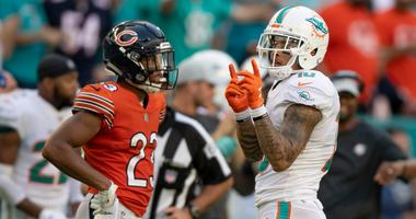 Dolphins receiver Kenny Stills (10) reacts after a reception in front of Bears cornerback Kyle Fuller.