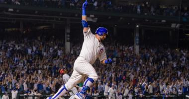 Cubs outfielder Kyle Schwarber celebrates his walk-off homer against the Reds.
