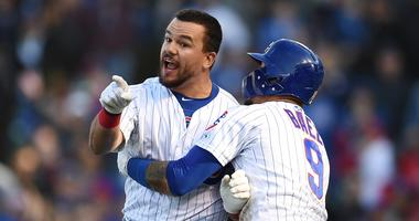 Kyle Schwarber, left, is held back by Cubs teammate Javier Baez as he angrily shouts at third-base umpire Gabe Morales after being called out on a check swing to end his team's loss.