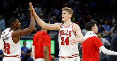 Bulls forward Lauri Markkanen (24) celebrates with guard Kris Dunn (32) after defeating the Magic.