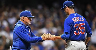 Cubs manager Joe Maddon pulls left-hander Cole Hamels from a game against the Brewers.