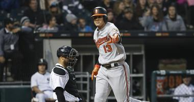 Orioles shortstop Manny Machado crosses home plate after homering.