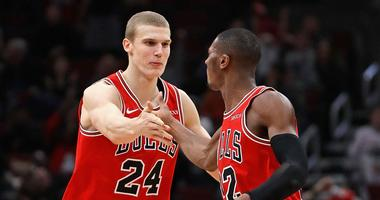 Bulls big man Lauri Markkanen, left, and point guard Kris Dunn celebrate.