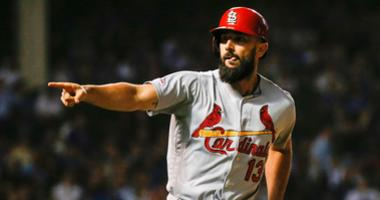 Cardinals infielder Matt Carpenter celebrates a go-ahead homer against the Cubs.