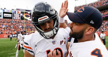 Bears quarterback Chase Daniel (4) celebrates with quarterback Mitchell Trubisky (10) after a win against the Broncos.