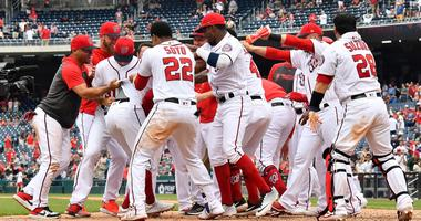Nationals shortstop Trea Turner (7) is congratulated by teammates after hitting a walk-off homer against the White Sox.
