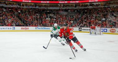 Blackhawks winger Patrick Kane (88) moves the puck up the ice.