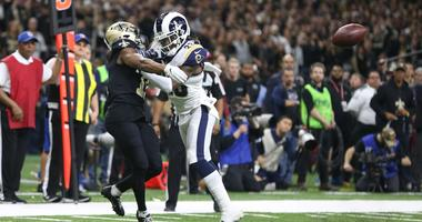 Rams defensive back Nickell Robey-Coleman (23) breaks up a pass intended for Saints receiver Tommylee Lewis (11). The NFL later admitted there should've been defensive pass interference on the play.