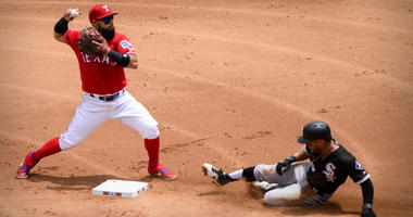 Rangers second baseman Rougned Odor (12) forces out White Sox second baseman Leury Garcia (28) and turns a double play.