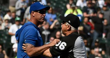 White Sox manager Rick Renteria (36) and Kansas City Royals bench coach Dale Sveum shove each other as the benches clear after Chicago shortstop Tim Anderson (not pictured) was hit by a pitch.