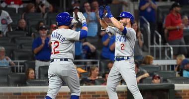 Cubs third baseman Tommy La Stella (2) celebrates with left fielder Kyle Schwarber (12) after hitting a homer.