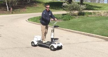 David Schuster on a golf board